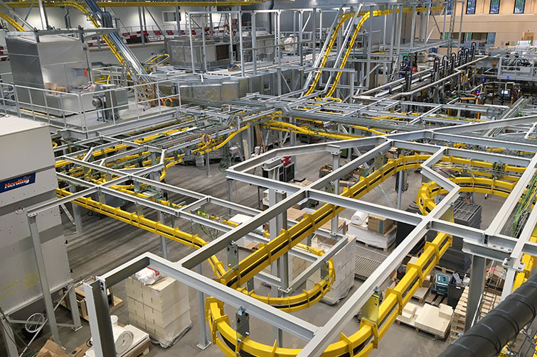 View of the whole plant from the gallery. The yellow components are part of the P&F hanger transport system. Status May 2021.